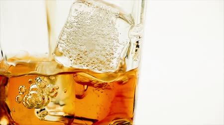 nightcap : close-up pouring whiskey on white background, whisky relax time concept Stock Footage