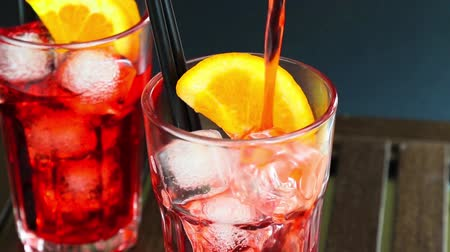 lounge : Two glasses of spritz aperitif aperol cocktail with two orange slices and ice cubes on wood table