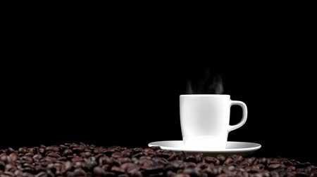 expressed : cup of coffee with smoke on roasted beans seed and black background