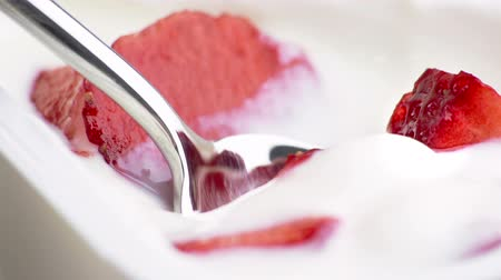 beslenme : close-up of healthy strawberry and white yogurt on the spoon, concept of healthy food nutrition