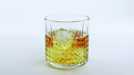 nightcap : barman pouring whiskey in the glass on white background, time of relax with whisky Stock Footage