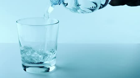 nutrição : filling a glass with water, nutrition and health-care concept