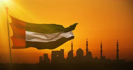 эмираты : animation waving fabric texture of the flag with color of united arab emirates at sunset with sun rays light, uae on mosque silhouette in background