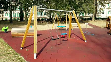 без вести пропавшие : empty swings with chains for children, moved from wind, shot in slow