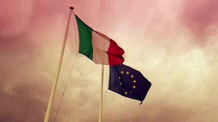 eur : waving fabric texture of the flag of italy and union europe
