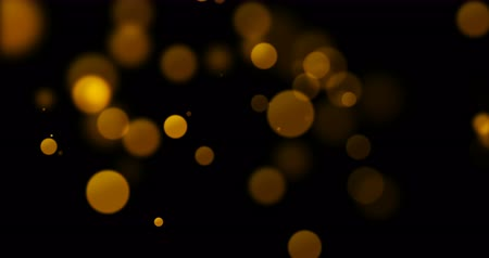 боке : abstract gold glow particles on black background, happy holiday new year event