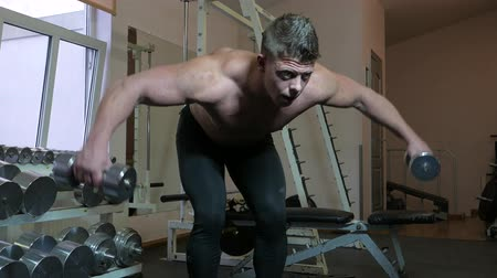 bicep : Bodybuilder in a gym Stock Footage