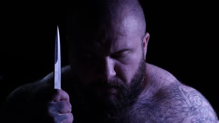 broda : Bald tattoed bearded muscular gangster with a knife. 4K UHD