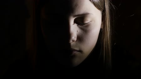 Łzy : 2Depressed teen girl is scared by something in the dark. 4K UHD.