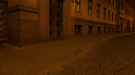 points of interest : POV walk through a dark street in a city.