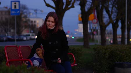 pincher : Teen girl with a little dog on a night street Stock Footage
