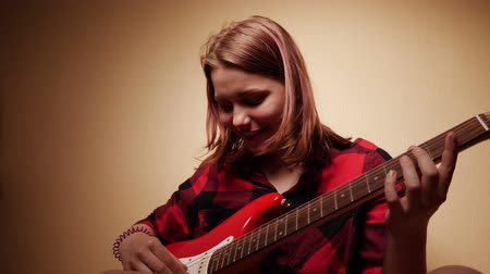 acoustical : Teen Girl Playing Guitar At Home. Close-Up 4K Slow motion Stock Footage