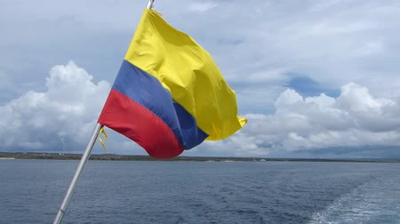 equador : National flag of Ecuador flying in a wind on a boat, Galapagos islands Vídeos
