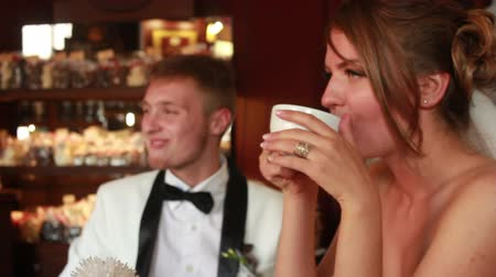 hot beverage : bride and groom drinking tea in a cafe