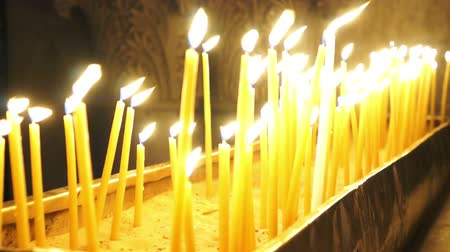 sepulcher : People light candles and put on a stand in the Temple of the Holy Sepulchre