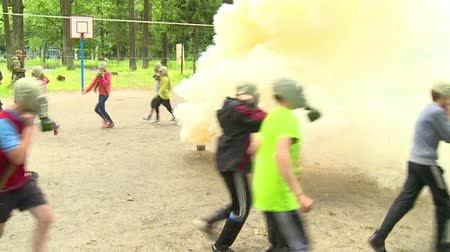 gas : children run around in masks smoke signal Stock Footage