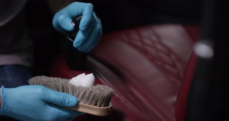 stain : Detailing and cleaning of interior front seats at luxury modern cars. Car care concept