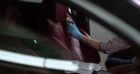 Detailing and cleaning of interior front seats at luxury modern cars. Car care concept