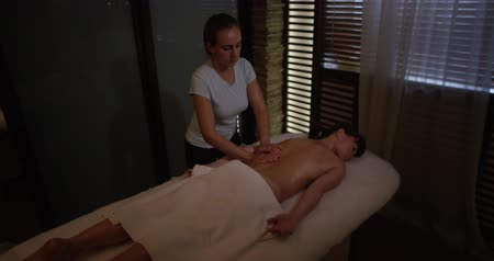 Woman having a great back massage in beauty spa center