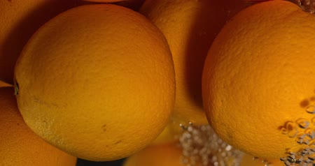 Orange Drops Under Water on Black Background. Fresh Orange Fruit Plunging And Splashes Water. Water Air Bubbles Wideo
