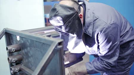 train workers : Industrial worker welding in factory Stock Footage