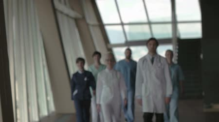 blur : doctors team walking in modern hospital corridor indoors, poeople group Stock Footage