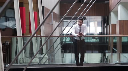 phablet : close up of young business man using smart phone for text messages and work
