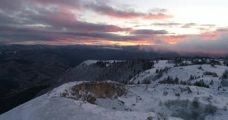 winter sunrise with fresh snow in alps mountains on fresh morning