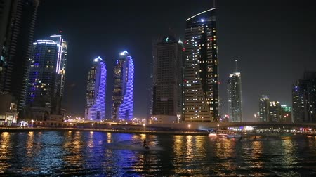 эмираты : Skyscrapers of Dubai at night and the boat
