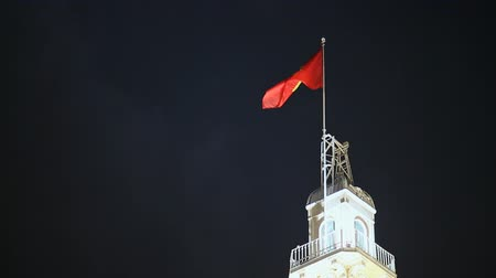 hall : Vietnamese flag on the tower of the city hall in the night Saigon