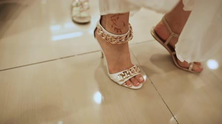 eleganckie : The girl tries on sandals foot in shoe store