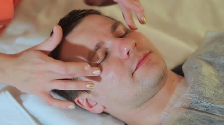 shiatsu : Man getting massage in the spa centre. Massage the face and neck. Stock Footage