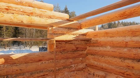log cabin : Unterminated building walls. Canadian angle masonry. Canadian style. Wooden house made of logs.