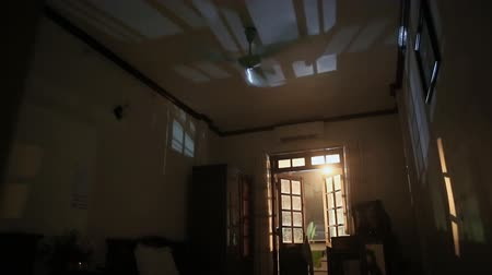 daireler : A dark room at night where the fan is running.