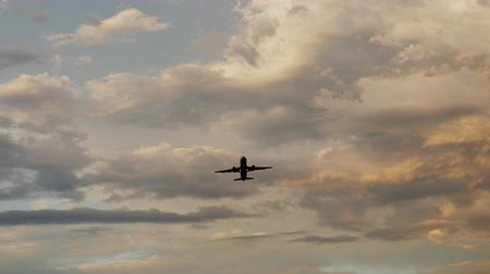 taking flight : Passenger airplane taking off at sunset against the background of a very beautiful clouds. Stock Footage