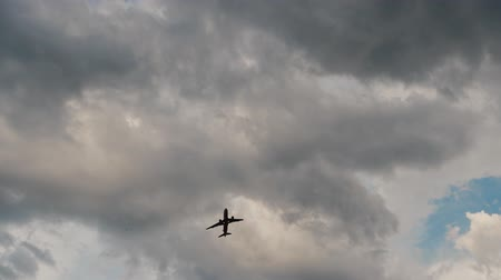komerční : Passenger airplane taking off at sunset against the background of evening clouds.