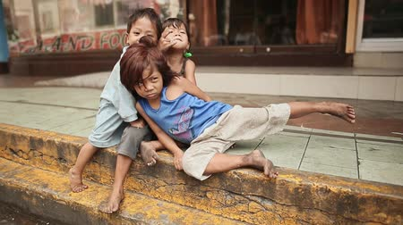 forget : MANILA, PHILIPPINES - JANUARY 5, 2018: Dirty, homeless and hungry children on the streets of Manila. Philippines.