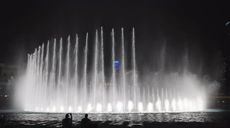 hajtások : Dubai, UAE - May 15, 2018: Majestic dancing fountains in Dubai.