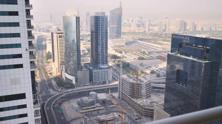 cityskyline : Dubai, UAE - May 15, 2018: Panorama of the area with skyscrapers in Dubai. Shooting in motion.