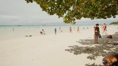 philippine : BORACAY, PHILIPPINES - JANUARY 5, 2018: People on a sunny white sandy beach of the Philippine tropics. Summer holidays for citizens and tourists. Exotic beach. Shooting in motion.