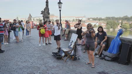 hradcany : Prague, Czech Republic - August 5, 2018: Street musicians play on the Charles Bridge Karluv Most . Stock Footage