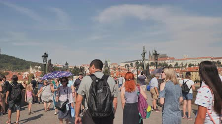 charles bridge : Prague, Czech Republic - August 5, 2018: Tourists walk on the Charles Bridge Karluv Most .