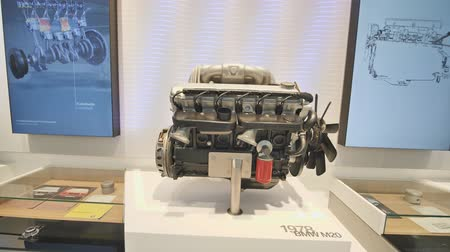 bavorské : Munich, Germany - August 5, 2018: Exhibition of car engines in the museum of BMW and BMW Headquarters, Munich, Bavaria, Germany.