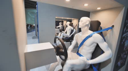 münchen : Munich, Germany - August 5, 2018: Exhibition of driver dummies behind the wheel in a BMW museum and BMW Headquarters, Munich, Bavaria, Germany.