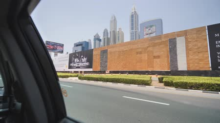 busy line : Dubai, UAE - May 15, 2018: Driving through the streets of Dubai. View from the car window.