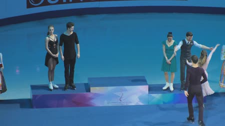 rövid : Minsk, Belarus - January 26, 2019: Skaters goes to the pedestal for awarding during the European Championship.