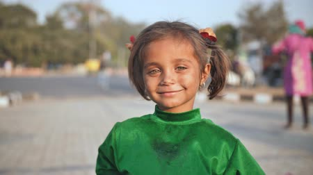 deprived : Delhi, India - November 28, 2018: Portraits of a poor child of a girl working and begging on the streets of Delhi.