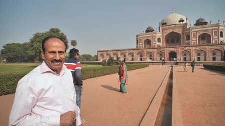 memorial day : Delhi, India - November 28, 2018: Indian guide talks about complex of buildings Humayuns tomb which is a World Heritage architecture.complex of buildings Humayuns tomb which is a World Heritage architecture.