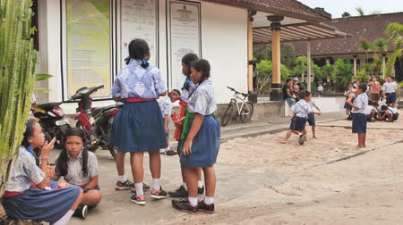 indonesia : Nusa Lembomgan, Indonesia - January 15, 2019: Indonesian schoolchildren in the schoolyard.