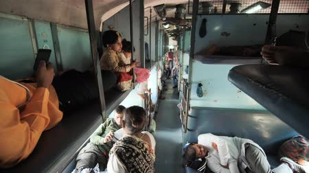 churn : Agra, India - December 12, 2018: Indian train and economy class carriage inside with passengers.
